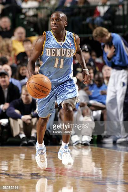 Earl Boykins of the Denver Nuggets moves the ball up court during the game against the Dallas Mavericks at American Airlines Arena on November 15...