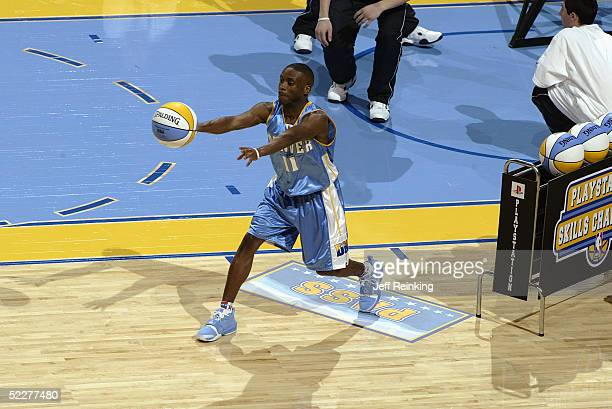 Earl Boykins of the Denver Nuggets passes in the PlayStation Skills Challenge during 2005 NBA AllStar Weekend at Pepsi Center on February 19 2005 in...