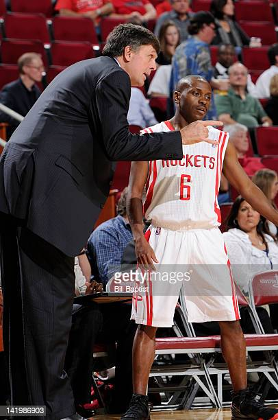 Earl Boykins of the Houston Rockets speaks to Head Coach Kevin McHale of the Houston Rockets during the game between the Houston Rockets and the...