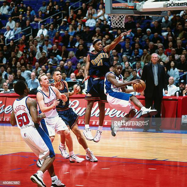 Earl Boykins of the Los Angeles Clippers passes the ball against the Denver Nuggets on January 10 2001 at Staples Center in Los Angeles CA NOTE TO...