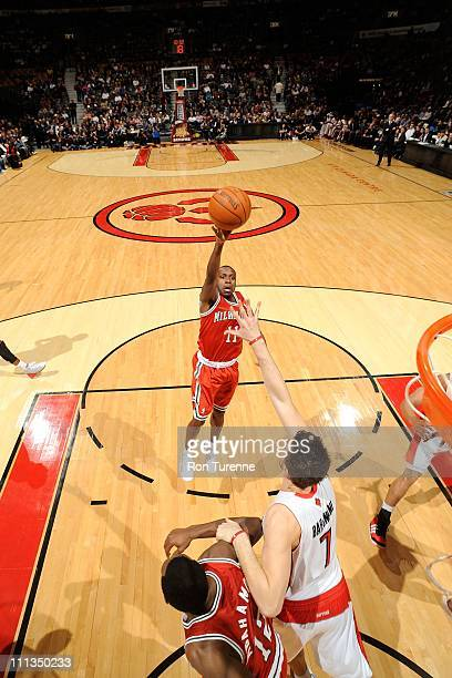 Earl Boykins of the Milwakee Bucks lays up the ball against the Toronto Raptors on March 30, 2011 at the Air Canada Centre in Toronto, Ontario,...