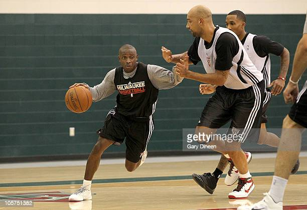 Earl Boykins of the Milwaukee Bucks drives past teammate Drew Gooden during a team practice on October 19, 2010 at the Milwaukee Bucks Training...