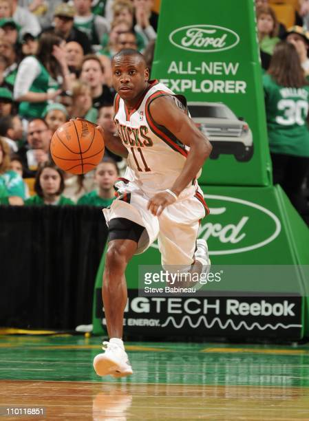 Earl Boykins of the Milwaukee Bucks handles the ball during the game against the Boston Celtics on March 13 2011 at the TD Garden in Boston...