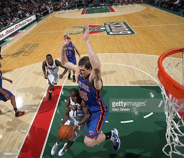 Earl Boykins of the Milwaukee Bucks shoots a layup against Timofey Mozgov of the New York Knicks during the NBA game on November 9, 2010 at the...