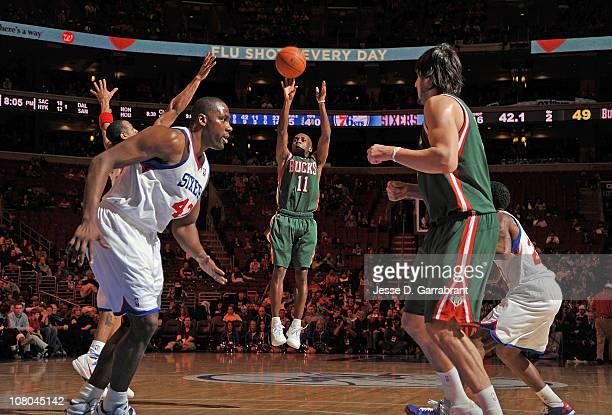 Earl Boykins of the Milwaukee Bucks shoots against the Philadelphia 76ers during the game on January 14 2011 at the Wells Fargo Center in...