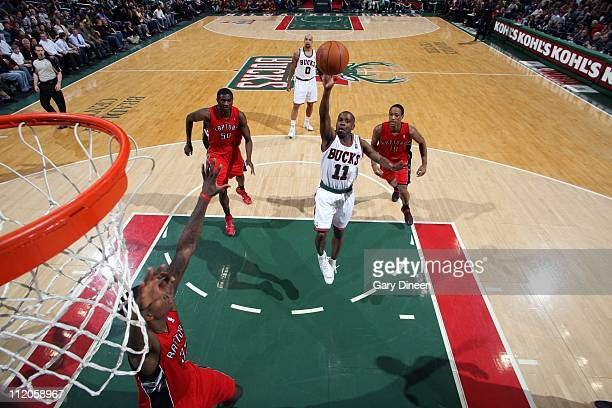 Earl Boykins of the Milwaukee Bucks shoots the ball against the Toronto Raptors during the game on April 11, 2011 at the Bradley Center in Milwaukee,...