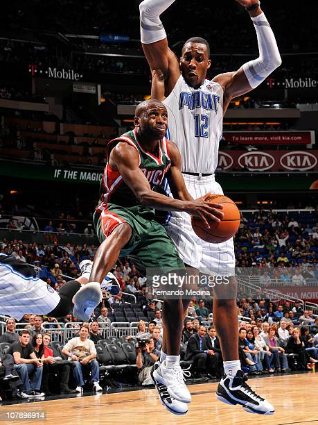 Earl Boykins of the Milwaukee Bucks takes the ball to the basket against Dwight Howard of the Orlando Magic on January 5 2011 at the Amway Center in...