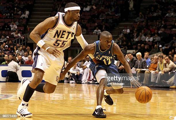 Earl Boykins of the Washington Wizards controls the ball against Keyon Dooling of the New Jersey Nets at the Izod Center on January 29 2010 in East...