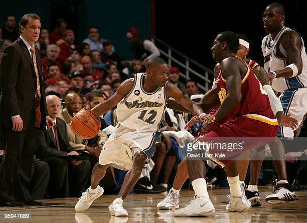 Earl Boykins of the Washington Wizards drives the ball around J.J. Hickson of the Cleveland Cavaliers during the game on January 6, 2010 at Quicken...