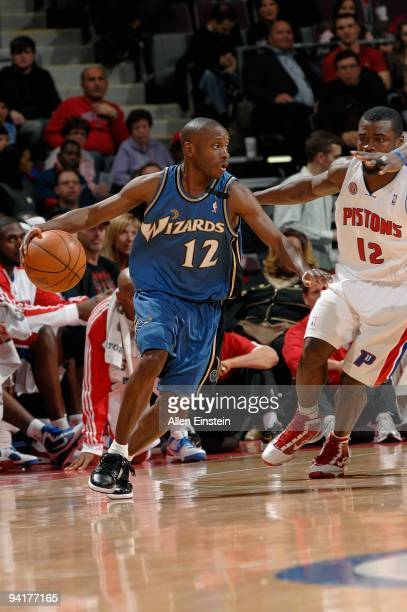 Earl Boykins of the Washington Wizards drives the ball around Will Bynum of the Detroit Pistons during the game on December 6, 2009 at The Palace of...