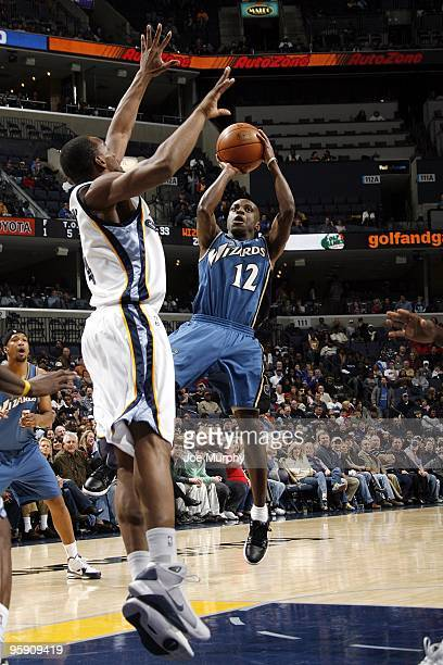 Earl Boykins of the Washington Wizards shoots a jumper against Sam Young of the Memphis Grizzlies during the game at the FedExForum on December 28,...