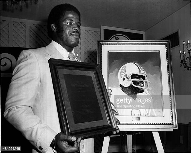Earl Campbell of the Houston Oilers accepts an award circa 1980s