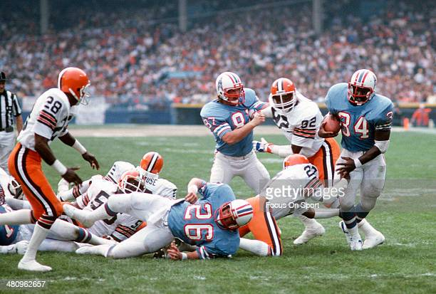 Earl Campbell of the Houston Oilers gets hit by Thom Darden of the Cleveland Browns during an NFL football game December 2 1979 at Cleveland...
