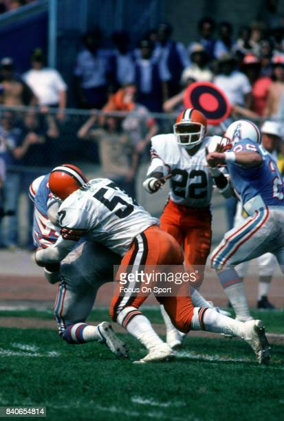 Earl Campbell of the Houston Oilers gets tackled by Clay Matthews Jr #57 of the Cleveland Browns during an NFL game September 13 1981 at Cleveland...