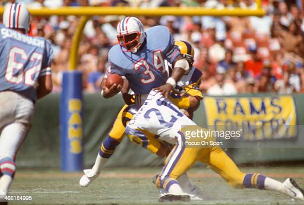 Earl Campbell of the Houston Oilers gets tackled by Nolan Cromwell of the Los Angeles Rams during an NFL Football game September 6 1981 at Anaheim...