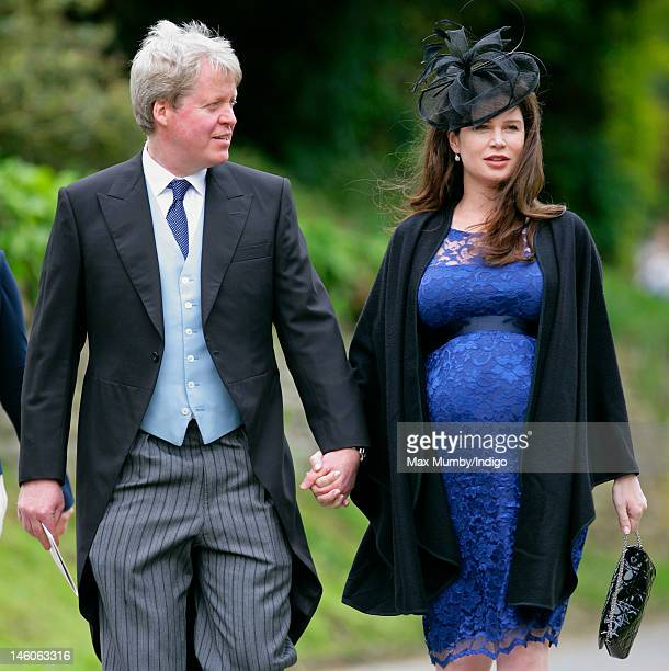 Earl Charles Spencer and his heavily pregnant wife Karen Spencer attend the wedding of Emily McCorquodale and James Hutt at The Church of St Andrew...