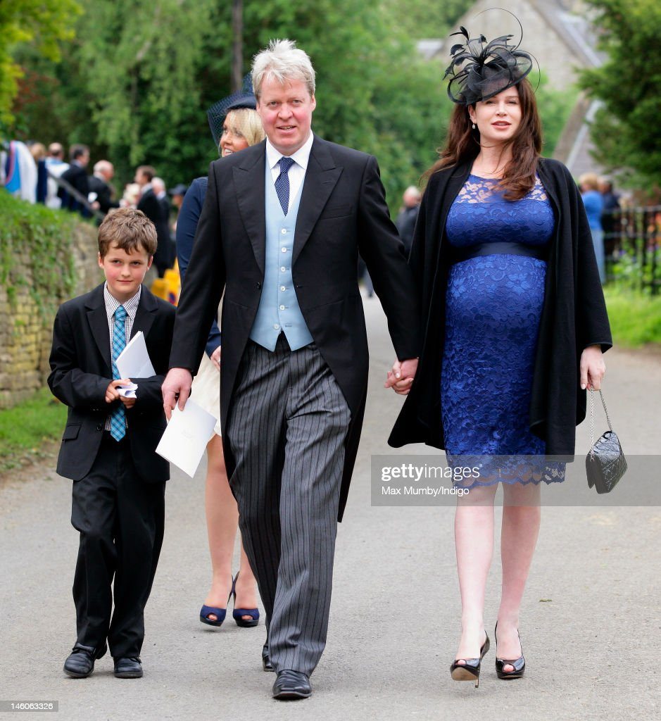 Earl Charles Spencer and his heavily pregnant wife Karen Spencer attend the wedding of Emily McCorquodale and James Hutt at The Church of St Andrew and St Mary, Stoke Rochford on June 9, 2012 in Grantham, England.