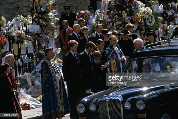 Earl Charles Spencer the younger brother of Princess Diana stands with Prince William Prince Harry Prince Charles and various priests and guests at...
