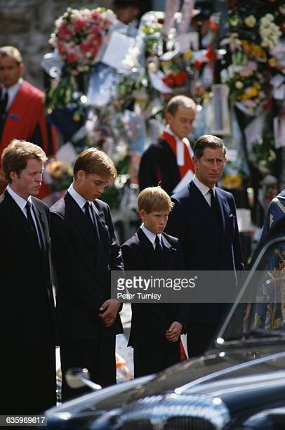 Earl Charles Spencer the younger brother of Princess Diana stands with Prince William Prince Harry and Prince Charles at the funeral of Diana...