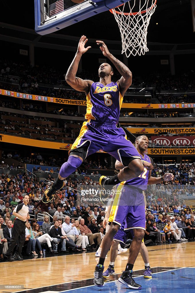 Earl Clark #6 of the Los Angeles Lakers grabs a rebound against the Orlando Magic during the game on March 12, 2013 at Amway Center in Orlando, Florida.