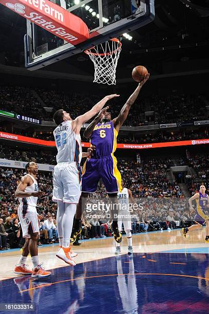 Earl Clark of the Los Angeles Lakers shoots against Byron Mullens of the Charlotte Bobcats on February 8 2013 at the Time Warner Cable Arena in...