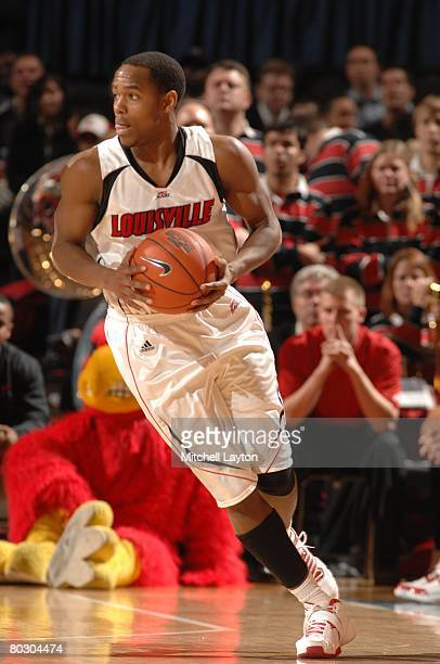 Earl Clark of the Louisville Cardinals looks to pass the ball against the Pittsburgh Panthers during the quarterfinals of the Big East Conferance...