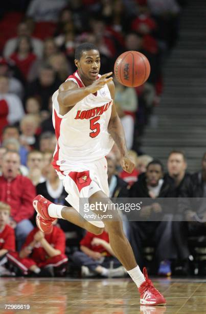 Earl Clark of the Louisville Cardinals moves for the ball during the game against the Northeastern Huskies on December 27, 2006 at Freedom Hall in...