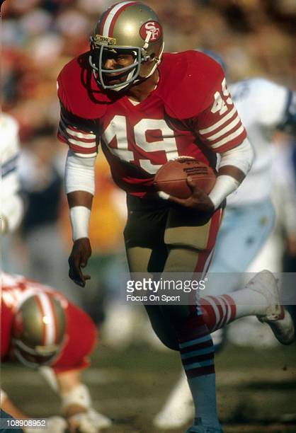 Earl Cooper of the San Francisco 49ers carries the ball against the Dallas Cowboys during an NFL football game at Candlestick Park October 11 1981 in...