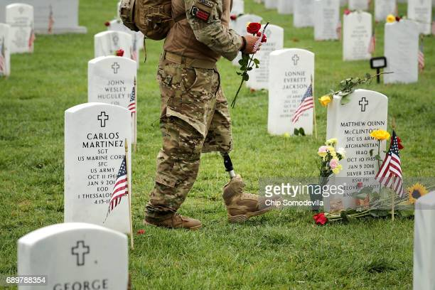 Earl Granville walks through Section 60 at Arlington National Cemetery on Memorial Day May 29 2017 in Arlington Virginia A member of the Pennsylvania...