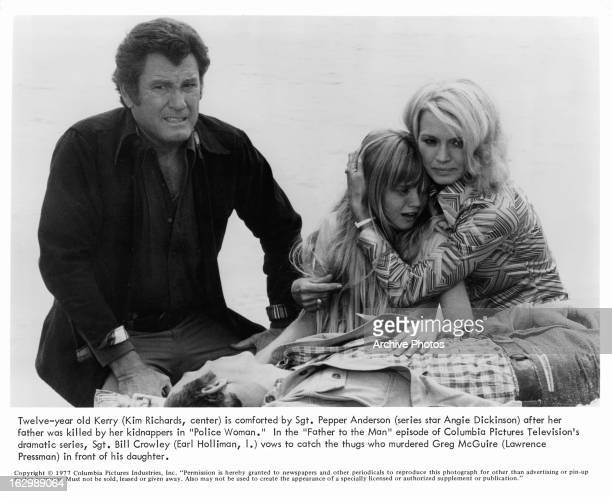Earl Holliman crouches over the body of Lawrence Pressman while Kim Richards cries and Angie Dickinson holds her in a scene from the television...