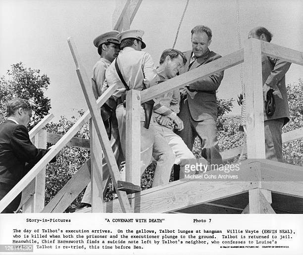 Earl Holliman on the gallows with Gene Hackman restraining him in a scene from the film 'A Covenant With Death' 1966 Photo by Warner Brothers/Getty...