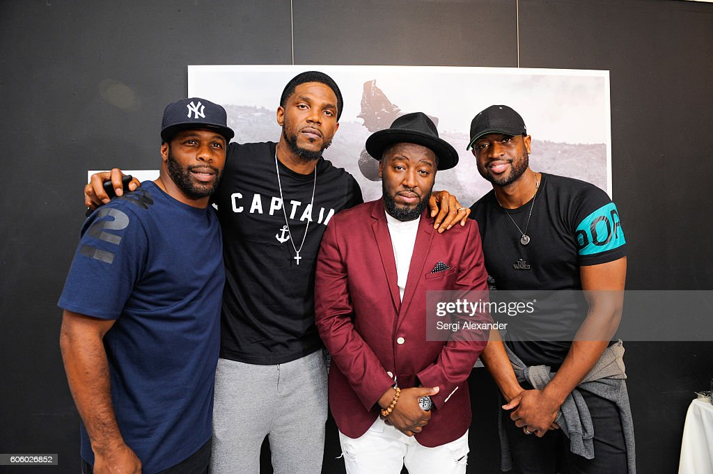 Earl Little, Udonis Haslem, Bob Metelus and Dwyane Wade attend Haitian photographer Bob Metelus unveils newest collection, Haiti: A Collective Cry from a Forgotten Paradise on September 15, 2016 in Miami, Florida.