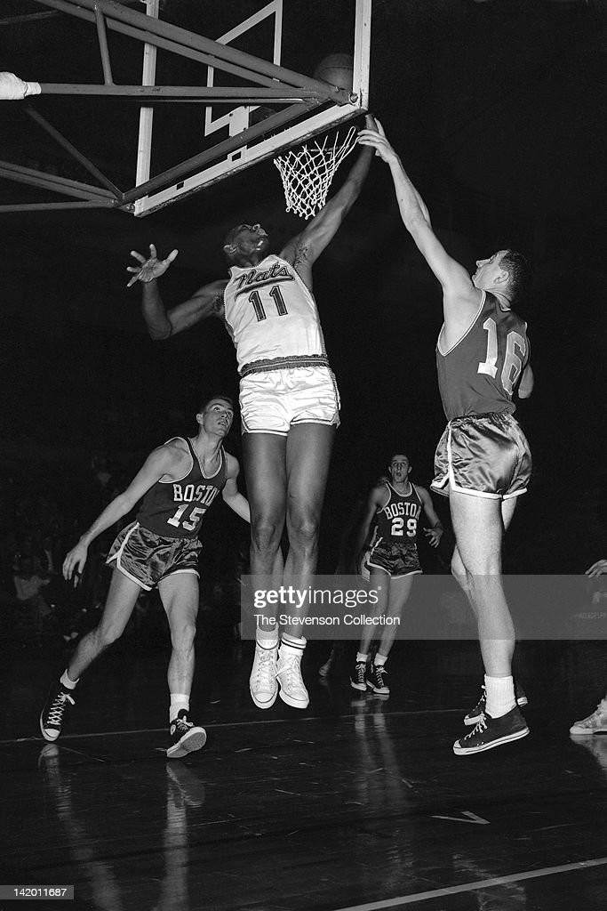 Earl Lloyd #11 of the Syracuse Nationals shoots against Jack Nichols #16 of the Boston Celtics circa 1958 at the Onondaga War Memorial Arena in Syracuse, New York.