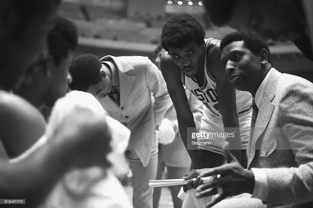 Earl Lloyd, the new Detroit Pistons coach, discusses game strategy during a second period time-out huddle as the Pistons play the Portland Trail Blazers here on October 10th. Leaning over his left shoulder is forward Curtis Rowe (#18) and to his left is center Dave Bing who is side lined with an eye injury. Lloyd, who replaced Bill Van Brada Kolff on November 3rd, coached the Pistons to a 132-129 win over Portland.