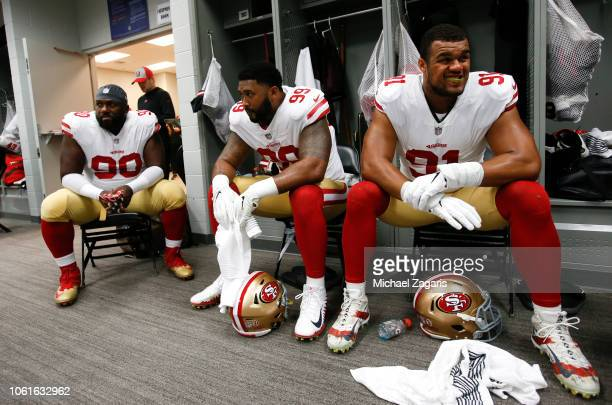 Earl Mitchell DeForest Buckner and Arik Armstead of the San Francisco 49ers sit in the locker room prior to the game against the Arizona Cardinals at...
