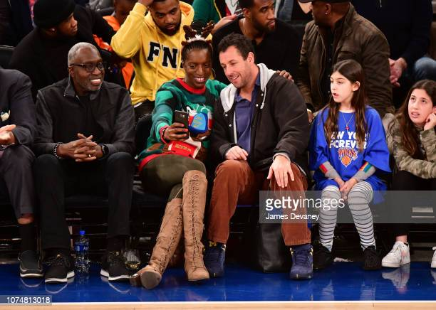 Earl Monroe and Adam Sandler attend the Milwaukee Bucks v New York Knicks game at Madison Square Garden on December 25 2018 in New York City