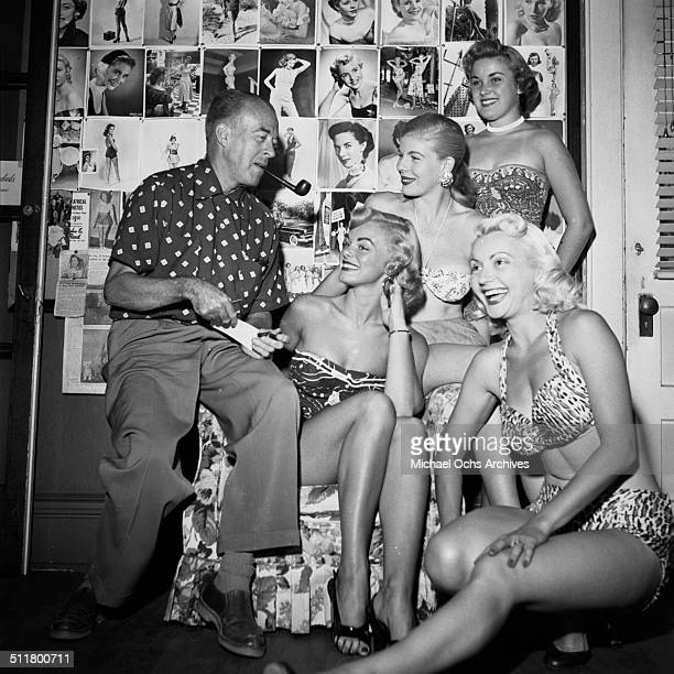 Earl Moreau talks with ladies in Harold Lloyd office in Los Angeles CA