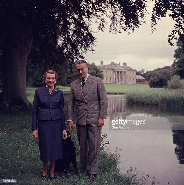 Earl Mountbatten of Burma and Lady Edwina Mountbatten walking in the grounds of Broadlands their Hampshire home with their dog