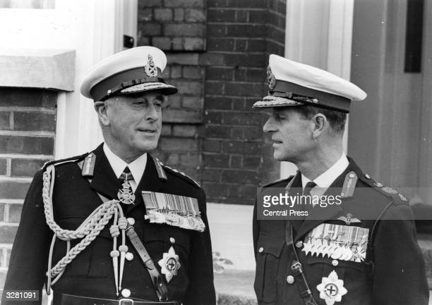 Earl Mountbatten of Burma with Prince Philip the Duke of Edinburgh who is his nephew They are both in the uniform of the Royal Marines