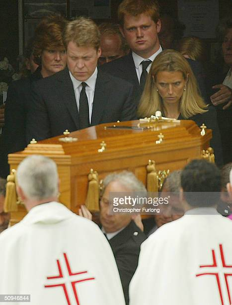 Earl Spencer his wife Caroline and sister Lady Sarah McCorquodale follow the coffin of their mother Frances Shand Kydd from the Cathedral of Saint...