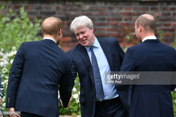 Earl Spencer is greeted by his nephews Prince William, Duke of Cambridge and Prince Harry, Duke of Sussex as he arrives for the Unveiling of a statue...