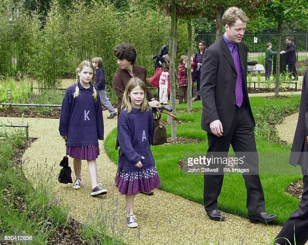 Earl Spencer with two of his children Kitty and Amelia at the opening of the Diana Princess of Wales memorial garden in Hyde park