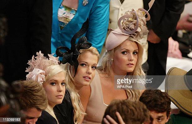 Earl Spencer's daughter's Lady Amelia Lady Eliza and Lady Kitty sit together inside Westminster Abbey ahead of the Royal Wedding of Prince William to...