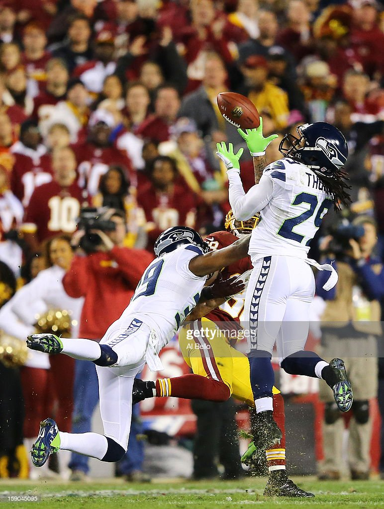 Earl Thomas #29 of the Seattle Seahawks intercepts a pass intended for Pierre Garcon #88 of the Washington Redskins in the second quarter during the NFC Wild Card Playoff Game at FedExField on January 6, 2013 in Landover, Maryland.