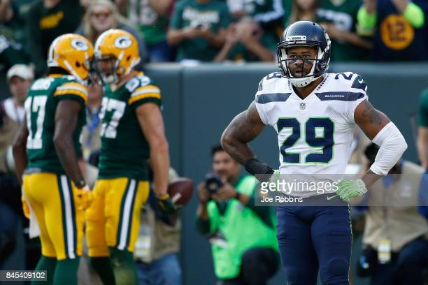 Earl Thomas of the Seattle Seahawks reacts after a third quarter touchdown reception by Jordy Nelson of the Green Bay Packers at Lambeau Field on...