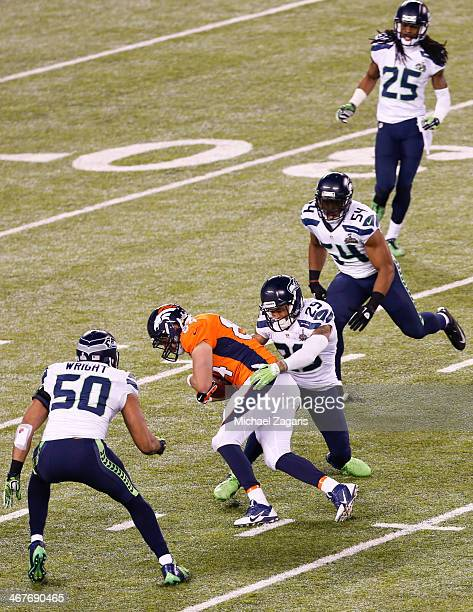 Earl Thomas of the Seattle Seahawks tackles Jacob Tamme of the Denver Broncos during Super Bowl XLVIII at MetLife Stadium on February 2 2014 in East...