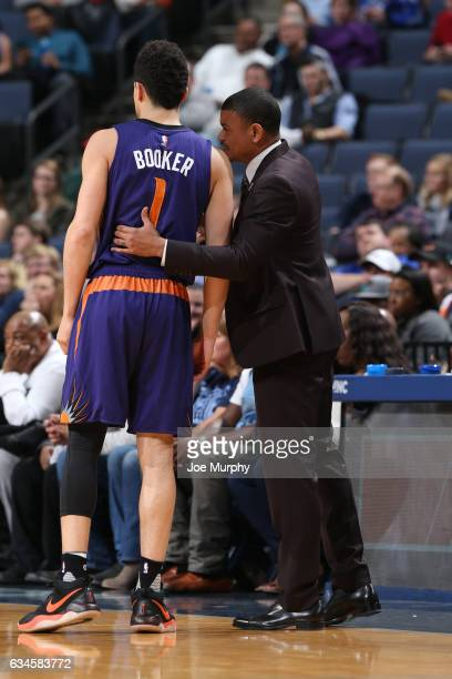 Earl Watson and Devin Booker of the Phoenix Suns talk during the game against the Memphis Grizzlies on February 8 2017 at FedExForum in Memphis...