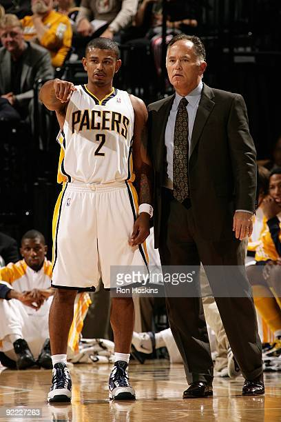 Earl Watson and head coach Jim O'Brien of the Indiana Pacers stand on the court during the preseason game against the Houston Rockets on October 16...