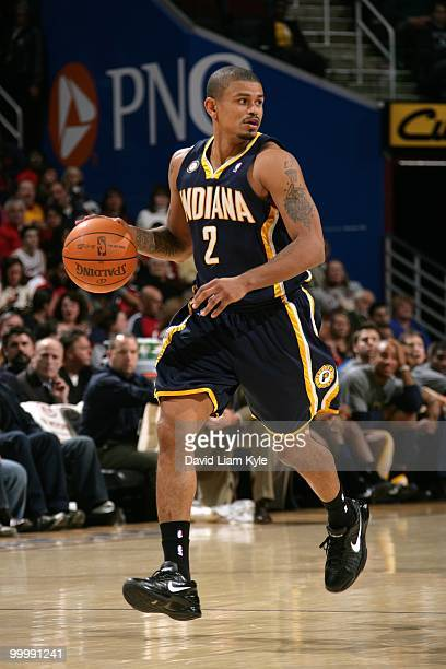 Earl Watson of the Indiana Pacers drives the ball against the Cleveland Cavaliers during the game at Quicken Loans Arena on April 9 2010 in Cleveland...
