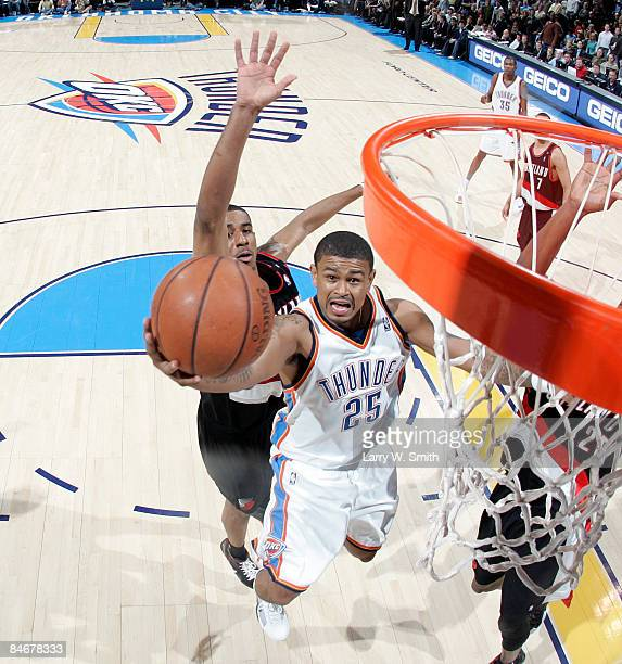 Earl Watson of the Oklahoma City Thunder goes to the basket against LaMarcus Aldridge of the Portland Trail Blazers at the Ford Center on February 6...